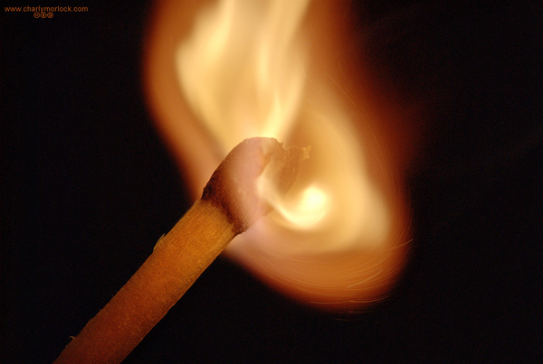 image of matchstick being lit